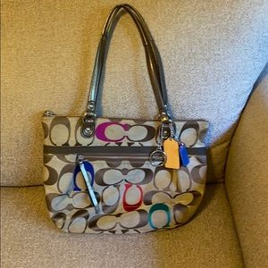 """Classic print with colored """"C"""" Coach purse"""